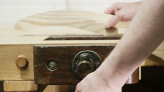 4K Furniture maker in his workshop, working on building a rocking chair - stock footage