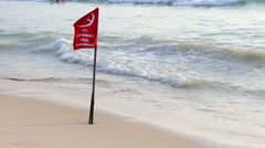 """no swimming"" warning red flag, tropical beach - stock footage"