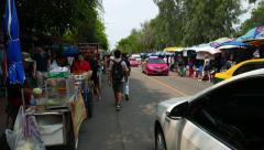 POV camera come along street food vendor carts, women selling meat on skewers Stock Footage