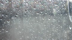 Raindrop on Glass plate Backgrounds Stock Footage