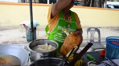 Thai people peeling Champedak or Artocarpus integer for cooking deep fried slice Stock Footage