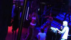 Female dancing show on a scene in club in night dresses, bathing suits - stock footage