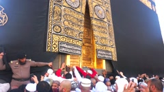 Pilgrims in front of Kaaba door (Multazam) inside Masjidil Haram Stock Footage