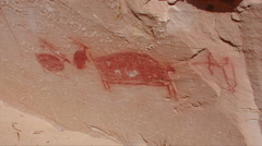 A hunting scene is represented in this petroglyph at Horseshoe Canyon in Utah Stock Footage