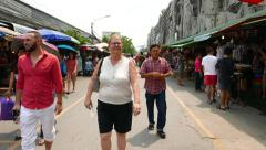 POV walking through Chatuchak market alley, tourist stroll around largest bazaar Stock Footage