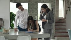 Real estate agent sign contract and giving home keys to happy couple Stock Footage