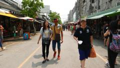 First person view walk through Chatuchak Weekend market alley Stock Footage
