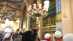 Pilgrims inside of Nabawi Mosque Stock Footage