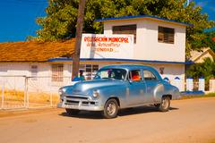 TRINIDAD, CUBA - SEPTEMBER 8, 2015: Old American cars used everyday due to - stock photo