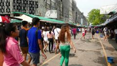 Side alley of Chatuchak market, tourist and visitors stroll around Stock Footage