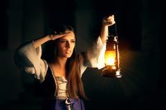 Beautiful Medieval Princess Holding Lantern Looking Outside Stock Photos