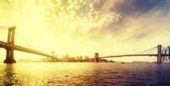 Vintage toned dramatic sunset over New York, USA. Stock Photos