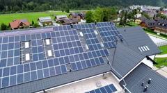 Blue solar panels on school roof Stock Footage