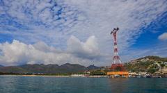 Rope way across sea bay near resort city against hills blue sky Stock Footage