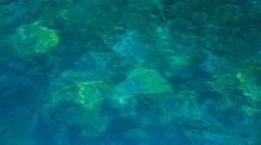 Upper view of transparent tranquil turquoise sea downwards Stock Footage