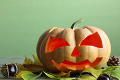 hallowen, pumpkin with chestnuts and leaves - stock photo