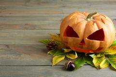 Hallowen, pumpkin with chestnuts and leaves Stock Photos