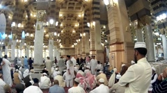 Pilgrims praying inside Nabawi Mosque Stock Footage