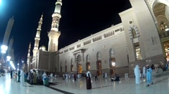 Stock Video Footage of Pilgrims walking at compound of Nabawi Mosque