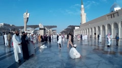 Stock Video Footage of Pilgrims at compound of Nabawi Mosque