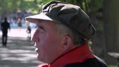 Retro french singer singing & playing barrel organ in public park - profile Stock Footage