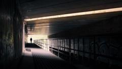 Man Walking Under Highway Bridge - stock footage