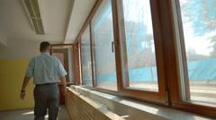 Men watching new windows Stock Footage