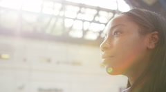 4K Beautiful young woman looking worried as she stands alone at railway station. Stock Footage