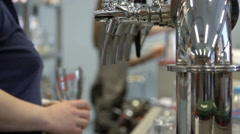 Barman pulling a pint of beer Stock Footage