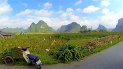Slow motion ride through village in mountainous countryside Vietnam. Stock Footage