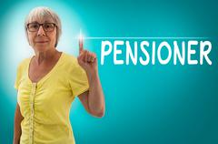 Pension touchscreen is shown by Senior woman concept - stock photo