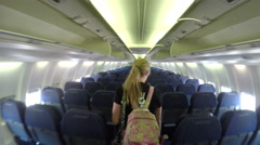 Tracking shot of girl exiting airplane Stock Footage
