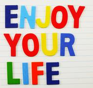 enjoy your life concep made from colorful alphabet - stock photo
