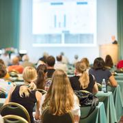 Audience in the conference hall. - stock photo