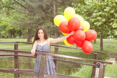 Happy, Beautiful, Carefree , Freedom Young Woman with Red and Yellow Balloons - stock photo