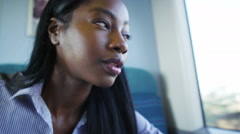 4K Tired young businesswoman working during train journey - stock footage