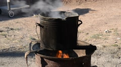 Outdoor fireplace with a cooking pot Stock Footage