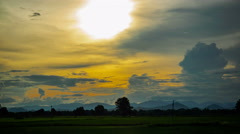 Sky over paddy field at sunset Stock Footage