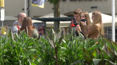 Woman recording a men talking and others assisting, Stuttgart Stock Footage
