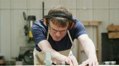 4K Professional carpenter in his workshop, cutting timber with a circular saw - stock footage