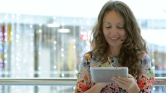 Young Beautiful Girl Using Tablet In A Public Place Stock Footage