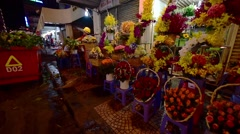 Vietnamese dustwoman at work in night Saigon flower market Stock Footage