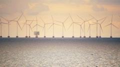 Green energy electricity ocean windfarm sunset Sweden Copenhagen DenmarK Stock Footage
