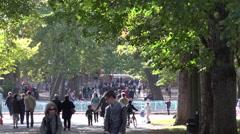 Retro french singer singing & playing barrel organ in public park - crowd 1 Stock Footage
