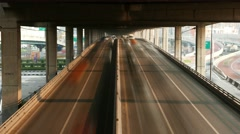 Inner-city motorway smooth time lapse hurry traffic ceaseless motion Stock Footage