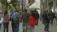 Tourists walking on Konigstrasse near Maute Benger clothing store, Stuttgart Stock Footage