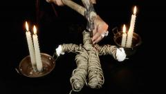 Voodoo doll candles hammer nails heart full Stock Footage