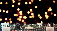 Burning candles and blinking bokeh lights loopable Stock Footage