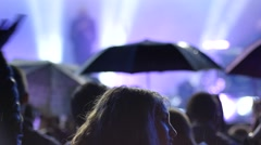 Cheering crowd audience silhouettes in lumiere light on a concert performance - stock footage
