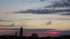 Sunset Over Farmland With A Factory In The Background Stock Footage